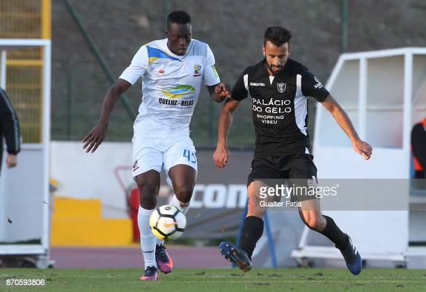 Viseu midfielder Fernando Ferreira with Real SC forward Abdoulaye Diallo from Senegal in action during the Segunda Liga match between Real SC and AC...