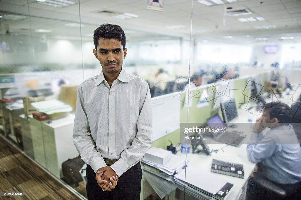 Vishal Agrawal, a foreign exchange trader at Standard Chartered Plc, stands for a photograph at the bank's office in Mumbai, India, on Thursday, June 9, 2016. Agrawal was diagnosed with the degenerative eye disease retinitis pigmentosa in 2004 as he was preparing to leave for under graduate study in U.S. Constrained by the diagnosis, he settled for studying accounting close to his home in Mumbai. Photographer: Prashanth Vishwanathan/Bloomberg via Getty Images