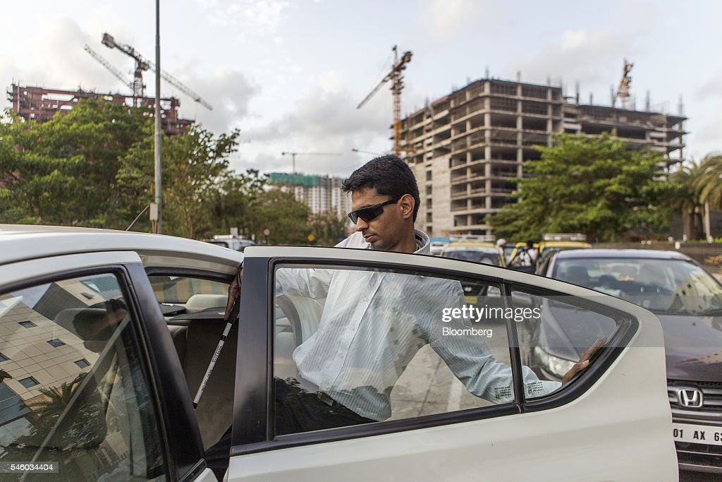 Vishal Agrawal, a foreign exchange trader at Standard Chartered Plc, enters an Uber Technology Inc. taxi in Mumbai, India, on Thursday, June 9, 2016. Agrawal was diagnosed with the degenerative eye disease retinitis pigmentosa in 2004 as he was preparing to leave for under graduate study in U.S. Constrained by the diagnosis, he settled for studying accounting close to his home in Mumbai. Photographer: Prashanth Vishwanathan/Bloomberg via Getty Images