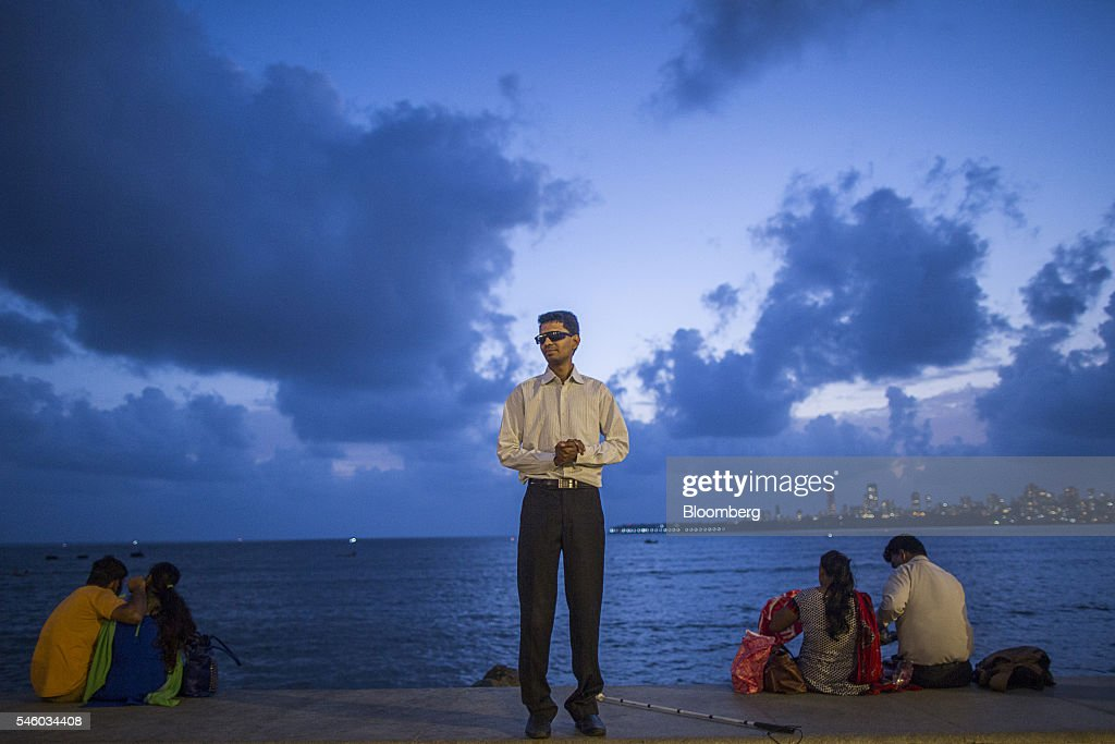 Vishal Agrawal, a foreign exchange trader at Standard Chartered Plc, stands for a photograph at Nariman Point in Mumbai, India, on Thursday, June 9, 2016. Agrawal was diagnosed with the degenerative eye disease retinitis pigmentosa in 2004 as he was preparing to leave for under graduate study in U.S. Constrained by the diagnosis, he settled for studying accounting close to his home in Mumbai. Photographer: Prashanth Vishwanathan/Bloomberg via Getty Images