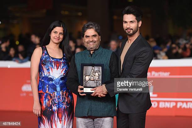 Vishal Bhardwaj Amrita Pandey and Shahid Kapoor pose with the People's Choice Award Mondo Genere during the Award Winners Photocall during the 9th...