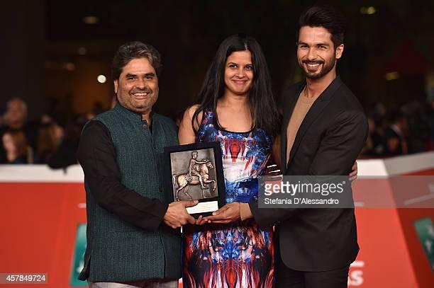 Vishal Bhardwaj Amrita Pandey and Shahid Kapoor pose with the People's Choice Award Mondo Genere at the Award Winners Photocall during the 9th Rome...