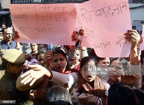 Vishwa Hindu Parishad's women wing Durga Vahini clash with police as they demonstrate against an art exhibition 'The Naked and the Nude' at Delhi Art...