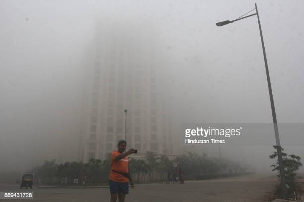 Visibility is low due dense smog in morning hours at Thane on December 9 2017 in Mumbai India A dense haze descended over Mumbai affecting visibility...