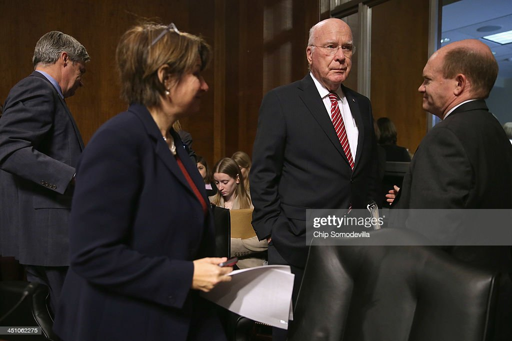 A visibly frustrated Senate Judiciary Committee Chairman Patrick Leahy (D-VT) (3rd L) and committee members (L-R) Sen. Sheldon Whitehouse (D-RI), Sen. Amy Klobuchar (D-MN) and Sen. Chris Coons (D-DE) after no Republican members of the committee showed up for a business meeting in the Dirksen Senate Office Building on Capitol Hill November 21, 2013 in Washington, DC. Because Republicans refused to attend the meeting Leahy and the committee Democrats were unable to have a quorum and vote on the nomination of 10 United States Circuit and District judges nominated by President Barack Obama.