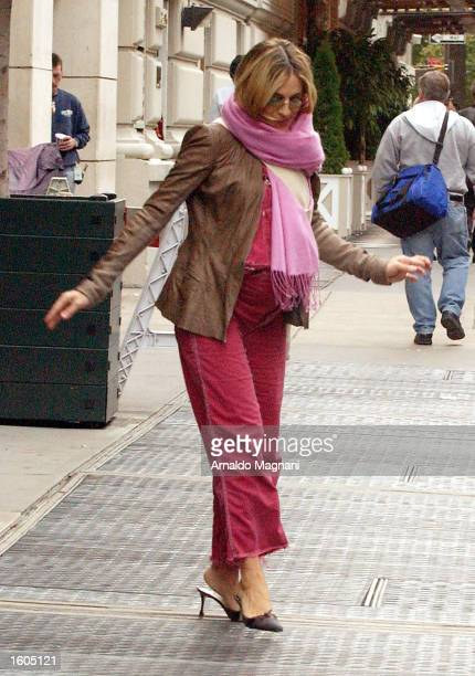 A visibly pregnant actress Sarah Jessica Parker carefully walks to her car October 17 2002 in New York City