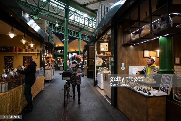 A visibly quiet Borough Market at lunchtime on March 12 2020 in London England The FTSE 100 Index fell 5054 per cent when trading opened in London...