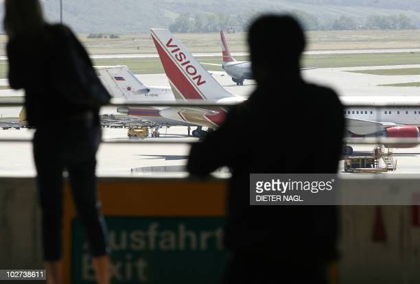 A Vision airlines plane presumed to be carrying 10 men and women who worked as Russian spies in the United States sits on the tarmac at Vienna...