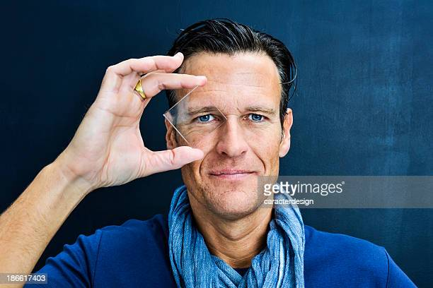 Vision: middle aged man looking through lens
