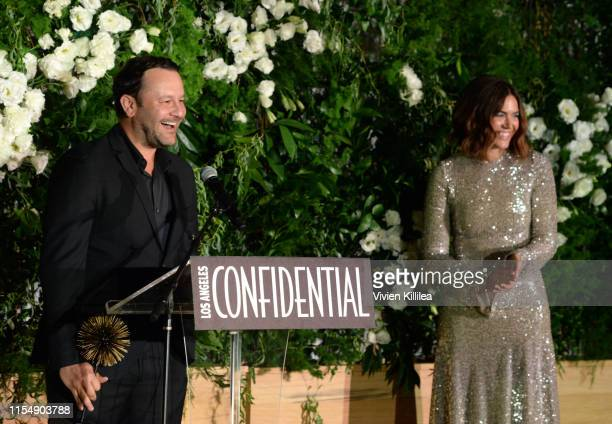 Visionary Award winner for 'This Is Us' Dan Fogelman and Mandy Moore are seen onstage during the Los Angeles Confidential Impact Awards at The LINE...