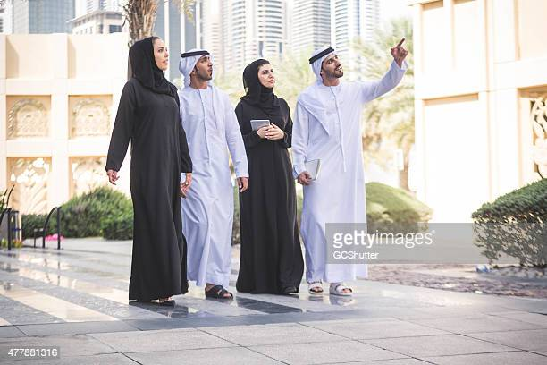 Visionary Business Men & Women in their traditional dress, UAE