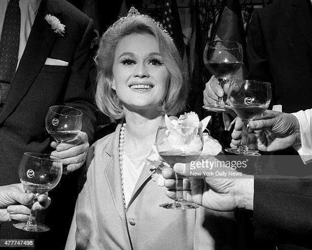 Visions of wine glasses dance in pretty actress Paula Wayne head No reason why they shouldn't for she's just been crowned May Wine Queen at the Savoy...