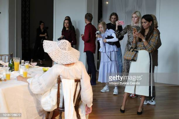 Visiots watch models at the Cathrine Hammel show during Oslo Runway SS19 at Bankplassen 4 on August 14 2018 in Oslo Norway