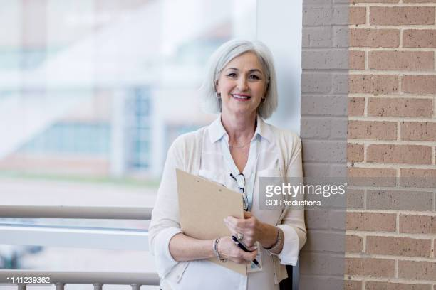 a visit from the school administrator - school principal stock pictures, royalty-free photos & images