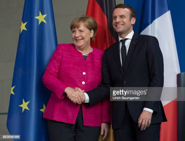 Visit in Berlin Emmanuel Macron President of the French Republic The photo shows Angela Merkel Federal Chanceloor female and Emmanuel Macron during...