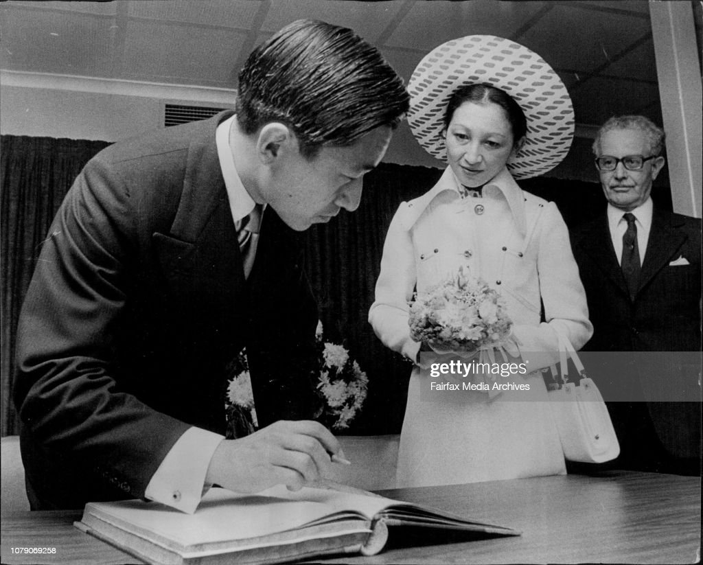 Visit of the Crown Prince of Japan to Sydney Hospital signs visitor book at the Kanematsu Memorial Institute watched by the Princess. : News Photo