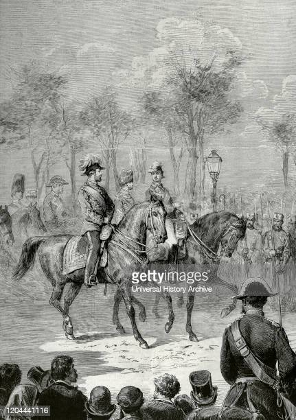 Visit of the Prince of Wales to Spain. Madrid. Prince Albert Edward , future Edward VII, and King Alfonso XII of Spain reviewing the troops at an...