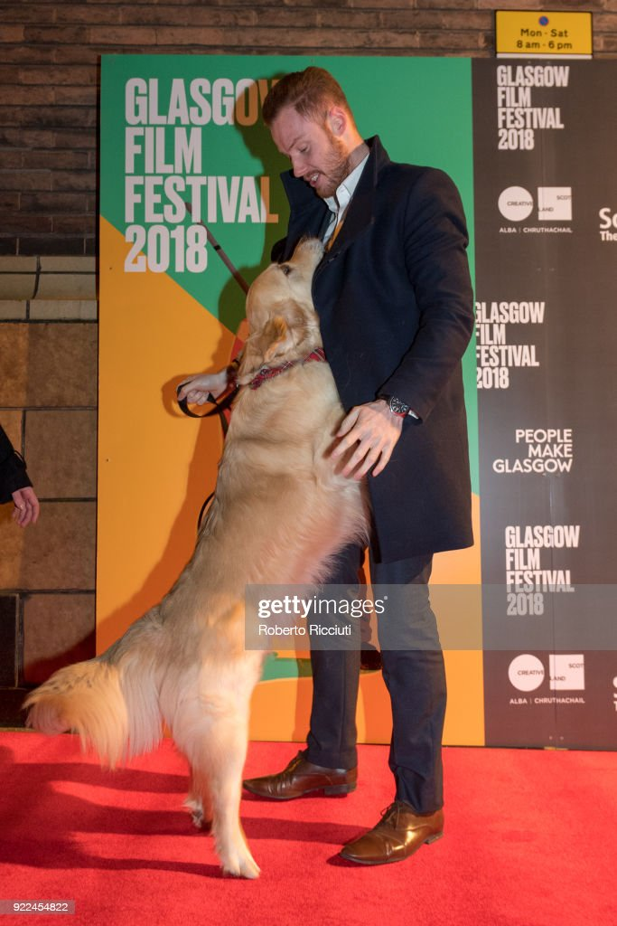 Visit Scotland Ambassador George plays on the red carpet with Gary Weir during the UK premiere of 'Isle of Dogs' and opening gala of the 14th Glasgow Film Festival at Glasgow Film Theatre on February 21, 2018 in Glasgow, Scotland.