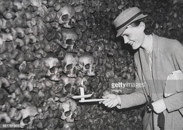 Visit the catacombs with thousands of skulls and other bones August 1934 Photograph