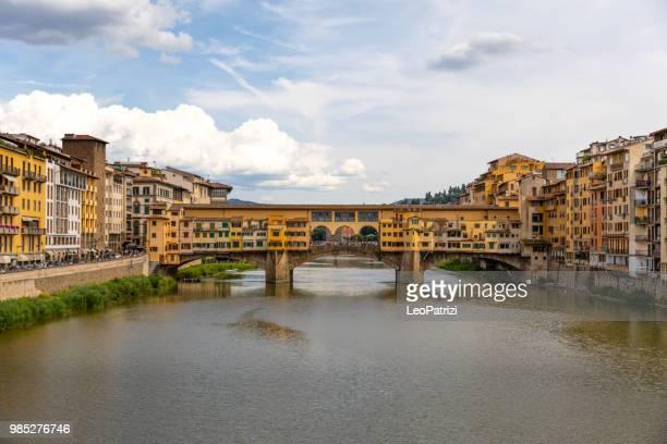 visit to florence, italy, ponte vecchio in a sunny day - centro storico foto e immagini stock