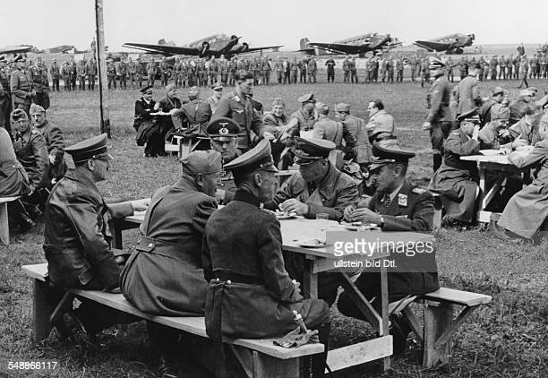 Visit to italian troops in the area of Uman in Ukraine lunch at the military airport base at the table from left Hitler Mussolini field marshall...