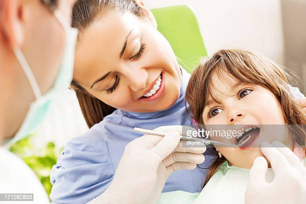 visit to the dentist. - pediatric dentistry stock photos and pictures