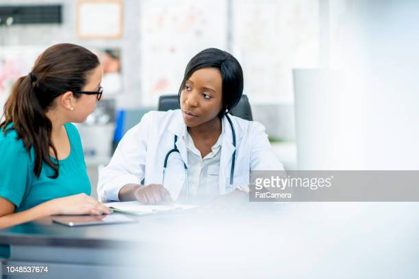 visit to the doctor - medical building stock pictures, royalty-free photos & images
