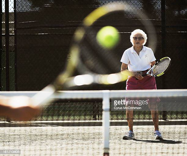 Visit with 100yearold Louise Donner at her tennis club the Pinehurst Country Club where she plays tennis with pro Marshall Carpenter twice a week on...