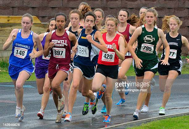 Visitation's Emily Kaplan sets the early pace and goes on to win the girls' 1600 meter run during the 31st annual Draper Invitational Track Meet held...