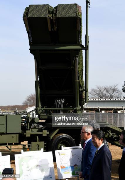 Visiting Australian Prime Minister Malcolm Turnbull and Japanese Prime Minister Shinzo Abe listen to a briefing on the PAC3 surfacetoair missile...