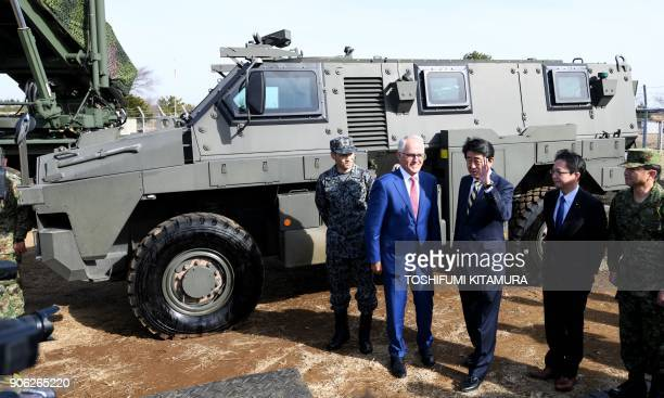 Visiting Australian Prime Minister Malcolm Turnbull holds a photo session with Japanese Prime Minister Shinzo Abe in front of an Australianmade...