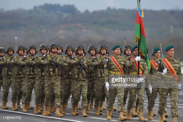 Visiting Azerbaijani troops march during the Pakistan Day parade in Islamabad on March 23 2019 Pakistan National Day commemorates the passing of the...