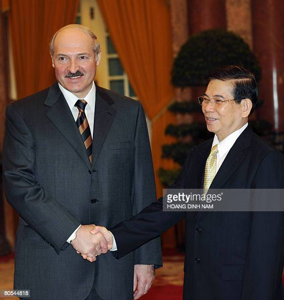 Visiting Belarus President Alexander Lukashenko is greeted by his Vietnamese counterpart Nguyen Minh Triet during a welcoming ceremony at the...
