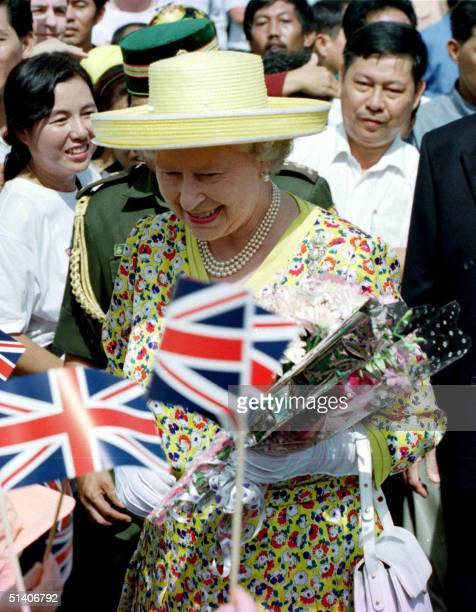 Visiting British monarch Queen Elizabeth II is greeted by British nationals and Bruneians upon her arrival at a market in capital Bandar Seri Begawan...