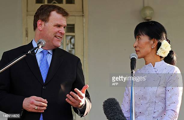 Visiting Canadian foreign affairs minister John Baird speaks to reporters following a meeting with Myanmar democracy icon Aung San Suu Kyi at her...