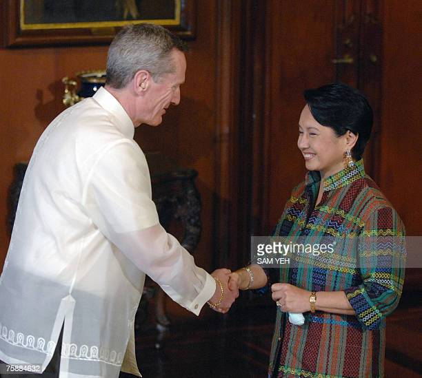 Visiting Canadian Foreign Minister Leonard Edwards is greeted by Philippines President Gloria Arroyo before dinner at Malacanang Presidential Palace...