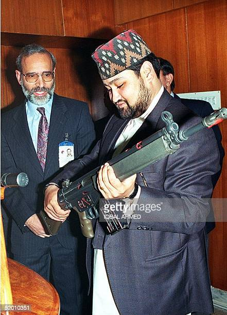 Visiting Crown Prince of Nepal Dipendra Bir Vikram Shah Dev examines an automatic rifle in Pakistan ordinance factory at Wah some 45 kilometres from...