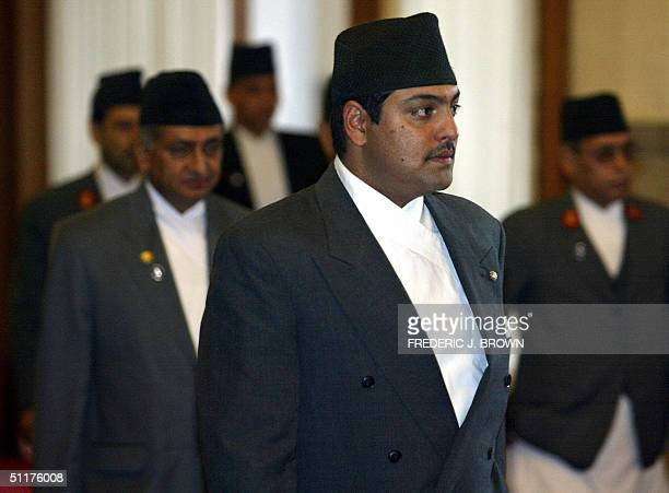 Visiting crown prince of Nepal Paras Bir Bikram Shah Dev leads his delegation into the Great Hall of the People in Beijing 16 August 2004 for a...