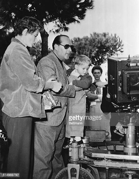 Visiting Daddy's Office Santa Marinella Italy Robertino Rossellini watches a movie camera with fascination while being held by his director father...