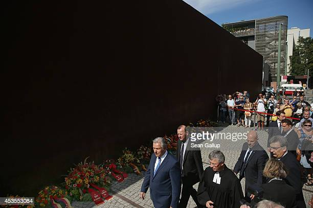 Visiting dignitaries, including Berlin Mayor Klaus Wowereit , arrive for a brief ceremony at a memorial at the former Berlin Wall on the 53rd...