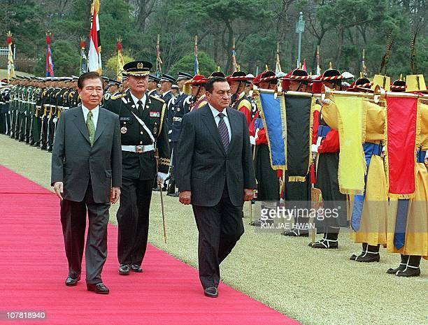 Visiting Egyptian President Hosni Mubarak passes an guard of honour with South Korean President Kim DaeJung during a welcoming ceremony at the Blue...