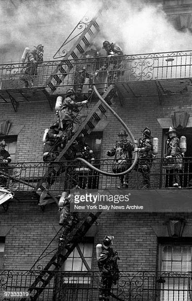 Visiting Firemen It looks like a firemen's convention on fire escape at 901 Ogden Ave Bronx scene of an allhands fire yesterday The men manage to...
