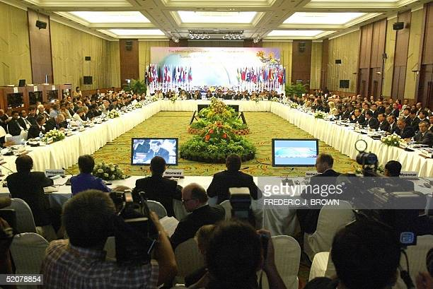 Visiting foreign ministers and delegates listen to a speech by Thailand Foreign Minister Dr Surakiart Sathirathai during ministerial meetings on...