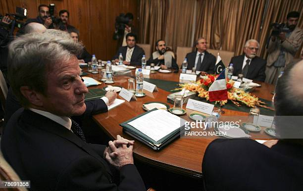 Visiting French Foreign Minister Bernard Kouchner attends a meeting with his Pakistani counterpart InamulHaq at the foreign ministry in Islamabad 02...