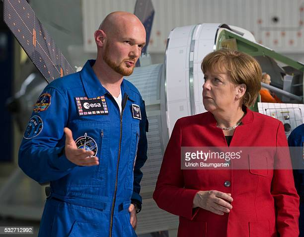 Visiting German Chancellor Angela Merkel at the German Center for aviation and aerospace Alexander Gerst German geophysicist and astronaut and Angela...
