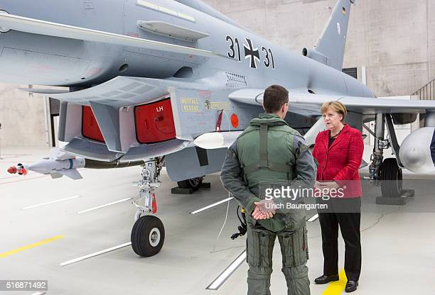 Visiting German Chancellor Angela Merkel at the Tactical Air Force Squadron 31 Boelke in Noervenich Merkel talking to a Euro Fighter pilot in front...