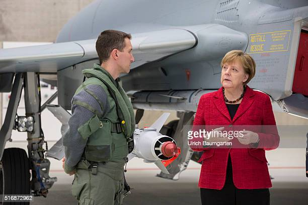 Visiting German Chancellor Angela Merkel at the Tactical Air Force Squadron 31 Boelke in Noervenich. Merkel talking to a Euro Fighter pilot in front...