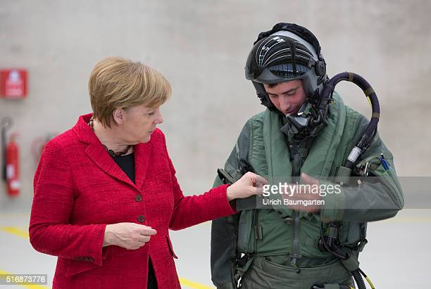 Visiting German Chancellor Angela Merkel at the Tactical Air Force Squadron 31 Boelke in Noervenich Merkel inspects equipment of a Euro Fighter pilot