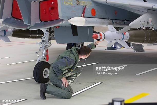 Visiting German Chancellor Angela Merkel at the Tactical Air Force Squadron 31 Boelcke in Noervenich Euro Fighter pilot inspects the weapons of his...