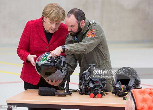 Visiting German Chancellor Angela Merkel at the Tactical Ait Force Squadron 31 Boelke in Noervenich Soldier of the Air Force declared Merkel...